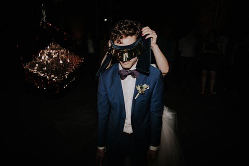 groom takes a shot at the pinata | Events Luxe Weddings