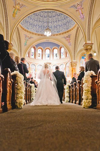 Bride down the aisle at st. stanislaus kostka church | Events Luxe Weddings