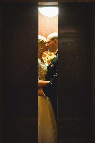 Bride & Groom sneak a kiss | events Luxe Weddings