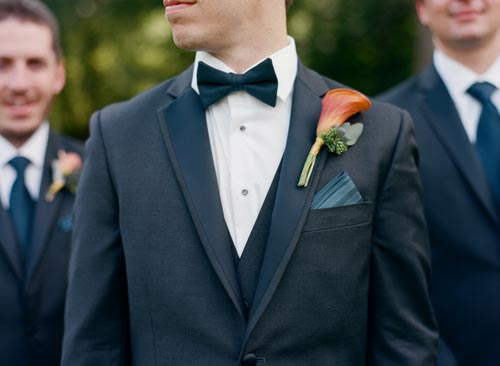 orange and blue calla lilly boutonniere | Events Luxe Weddings