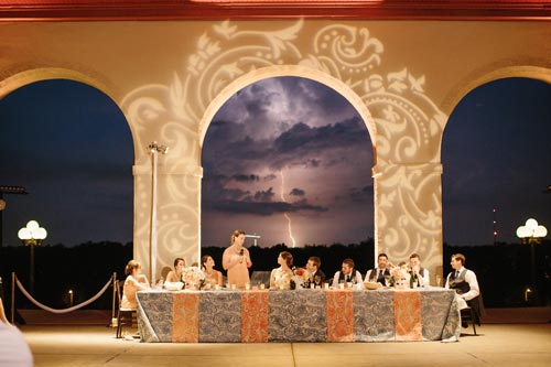 Bridal party table during thunderstorm at World's Fair Pavilion \ Events Luxe Weddings