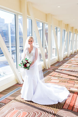 Bride at St. Francis Xavier College Church   Events Luxe Wedding