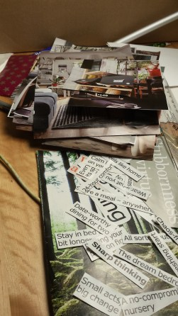 A pile of clippings from an IKEA catalogue rests on a hardwood table (also from IKEA).