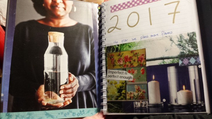 "Inside a book, clippings from a catalogue are glued in. On the left hand side a woman with brown skin holds out a glass of water, her face is occluded. On the right hand side a page reads ""2017: the year we plant more flowers."" Below this is a collage of images of trees, candles, and artwork featuring flowers. Over the collage are the words ""Imperfect is perfect enough."""