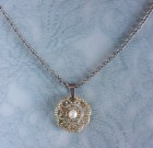 Gorgeous hand beaded silver necklace with a single freshwater pearl on a stainless steel chain.