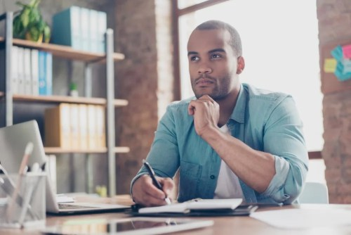 Business owner contemplating which cleaning company to hire