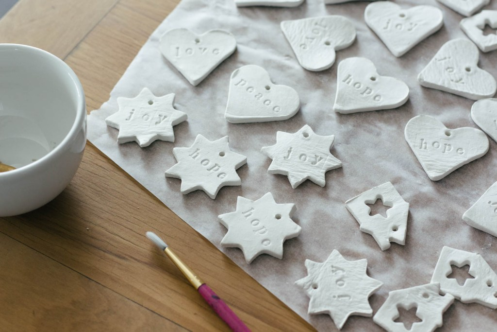 Hand-stamped clay tree decorations for Christmas