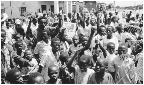 The people of Kalunga village celebrate the victory of Kintu Musoke in the 1994 nonpartisan general election in Uganda.