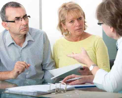 Couple getting advice from college Financial Aid Officer