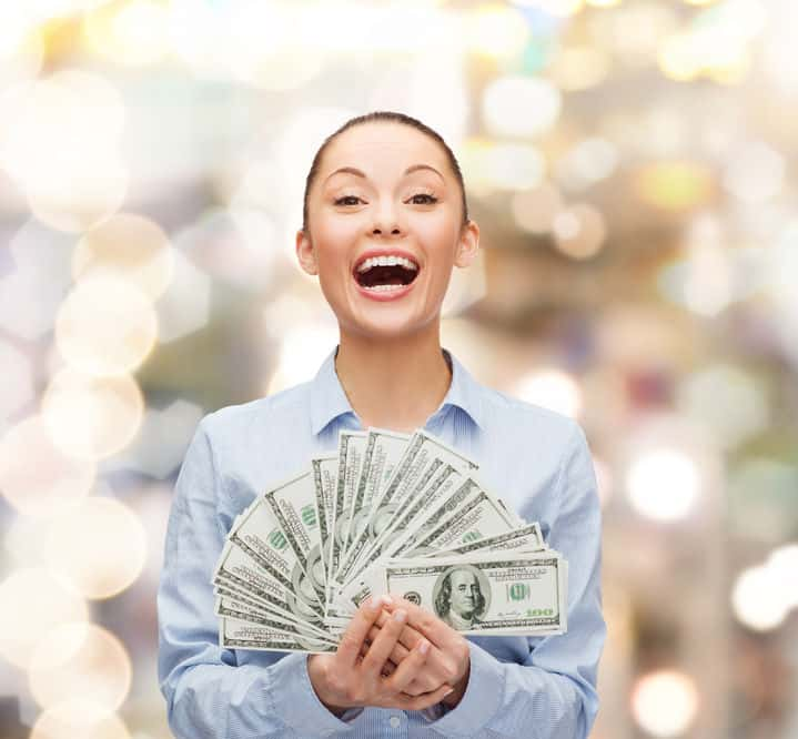 woman-with-accumulated-savings-in-cash