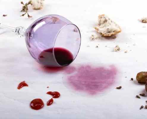 red-wine-stain-white-tablecloth