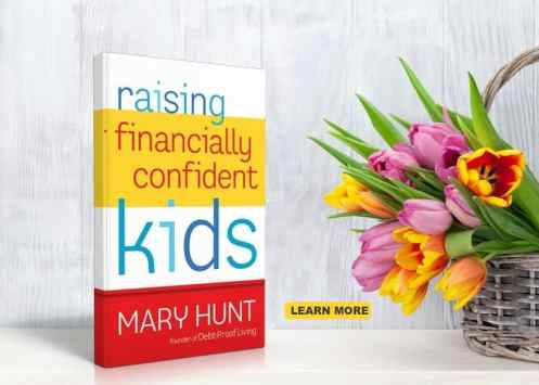 copy of raising financially confident kids by Mary Hunt sitting on a shelf next to a bouquet of flowers
