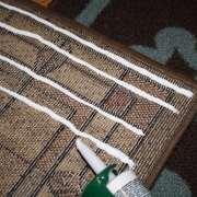 Repair area rug rubber backing with vinyl-latex caulk