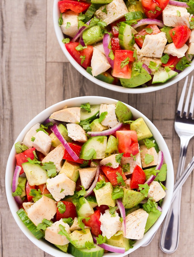 This healthy, satisfying Chicken, Avocado & Tomato Salad recipe is full of great, fresh flavors and is ready to eat in just 15 minutes! | EverydayEasyEats.com