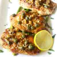 low carb lemon chicken piccata made with almond flour, white wine, shallots and capers.