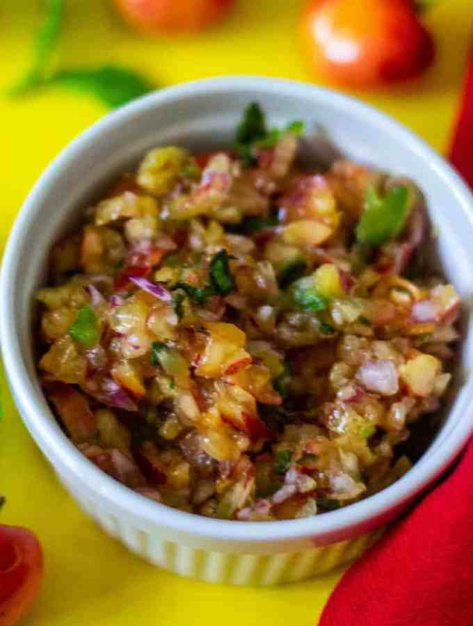 Fresh Cherry Salsa made with Skylar Rae®Cherries, jalapenos, herbs, lime juice in a white bowl. Ready to be served over poultry or served with chips