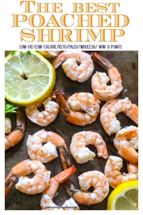 the best poached shrimp on a dark platter with lemon wedges around the shrimp.