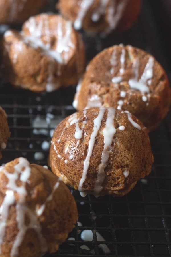 nordic ware apple cakelets with maple drizzle on a large cooling rack