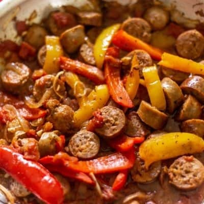 Sausage sauteed with peppers, onions, diced tomatoes, and seasonings in a large saute pan