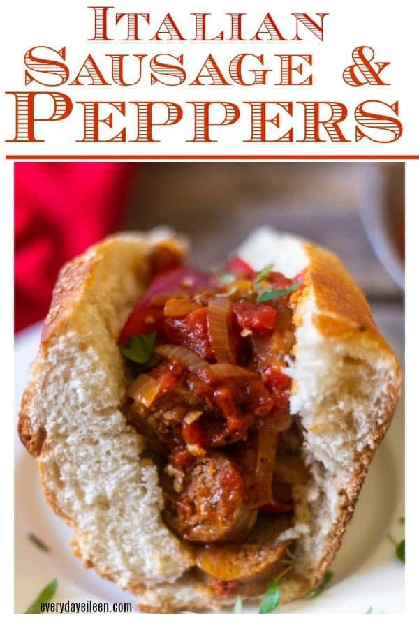 Italian Sausage and peppers in a large piece of Italian bread with sauteed diced tomatoes