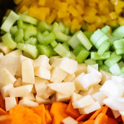 Carrots, potatoes, celery, yellow peppers, onions, and garlic - the ingredients for slow cooker Manhattan Clam Chowder