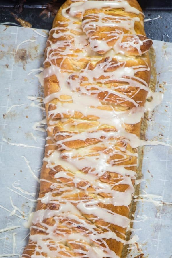 Cream cheese danish braid drizzled with icing.