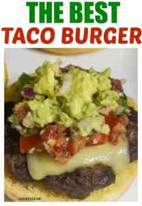 Delicious taco burger on a bun topped with pepper jack cheese, pico de gallo, and guacamole