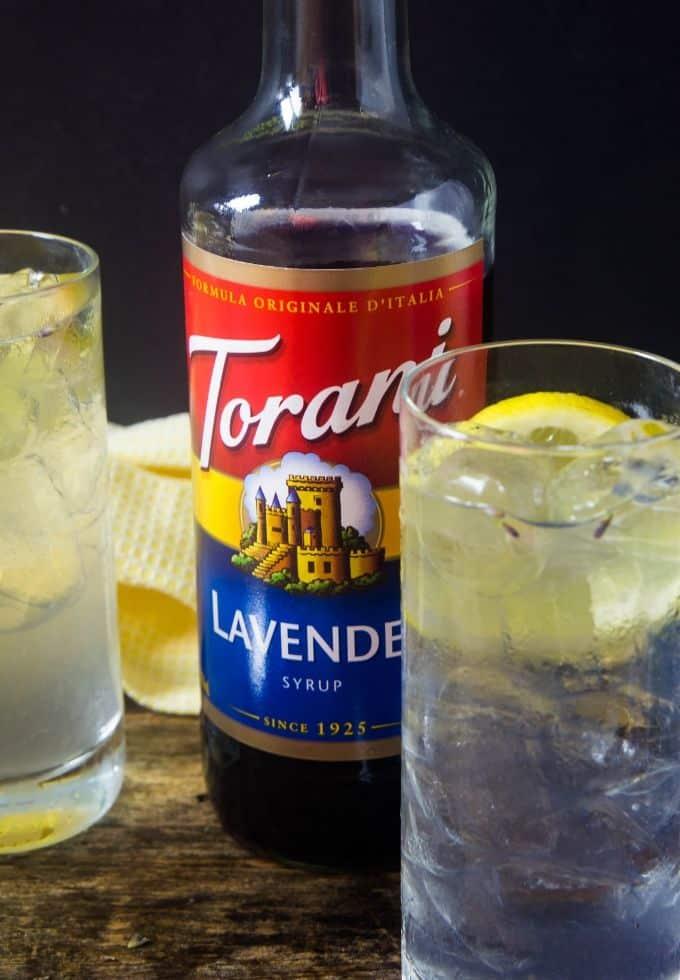 Lavender lemonade with Torani lavender syrup in between the lemonade glasses