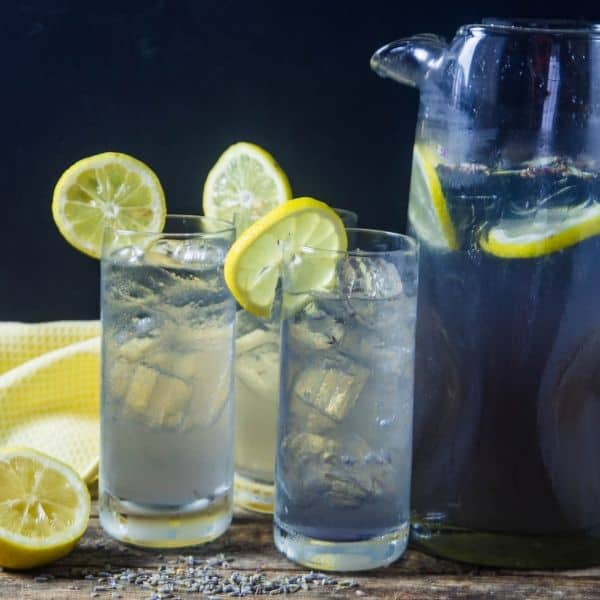 lavender lemonade made with Torani syrup served in joy jolt glasses