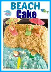 A festive cake decorated with a beach then with graham cracker sand, teddy graham people on candy blankets