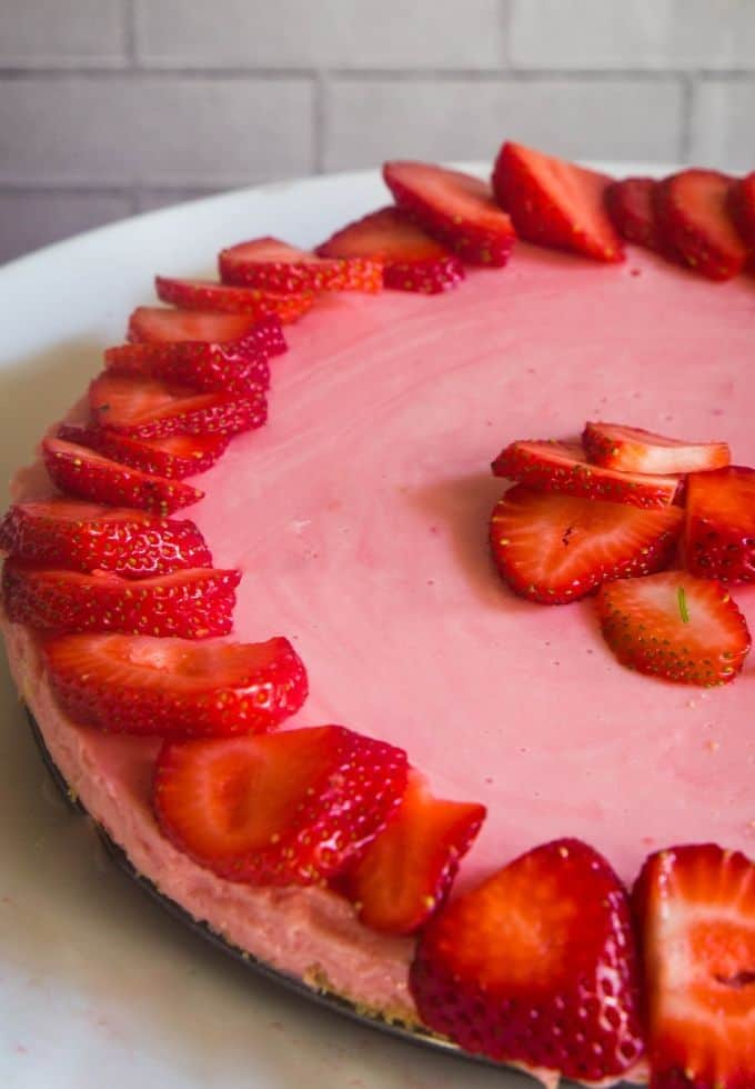 Refreshing no bake strawberry cheesecake topped with fresh strawberries