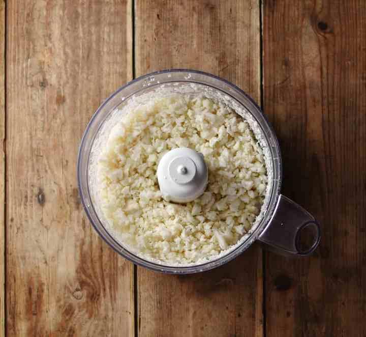 Cauliflower rice inside small blender.