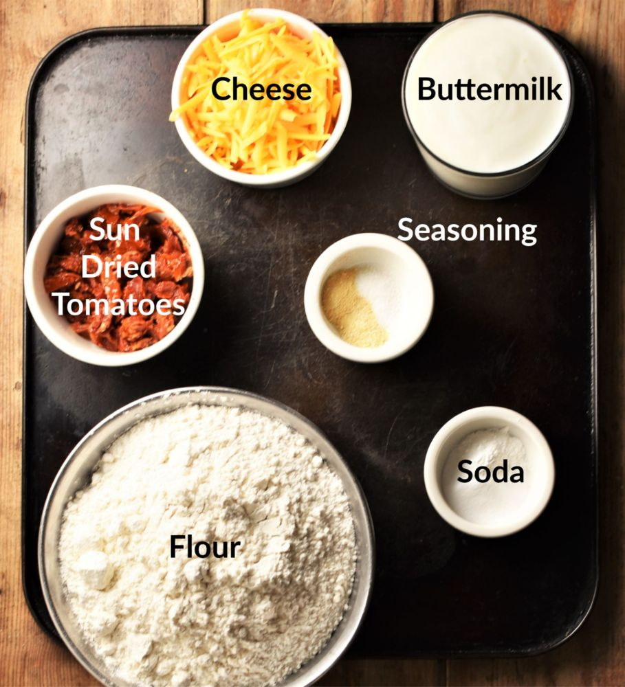 Sun dried tomato bread ingredients in individual dishes.