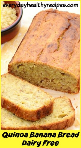 Side view of quinoa banana bread on round tray, banana and brown dish containing quinoa.