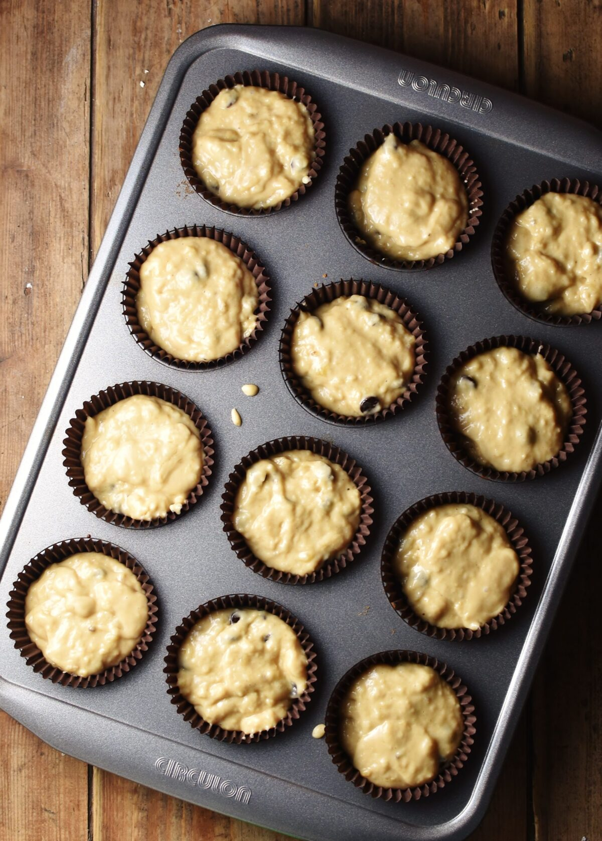 Unbaked muffins in 12-hole muffin pan.
