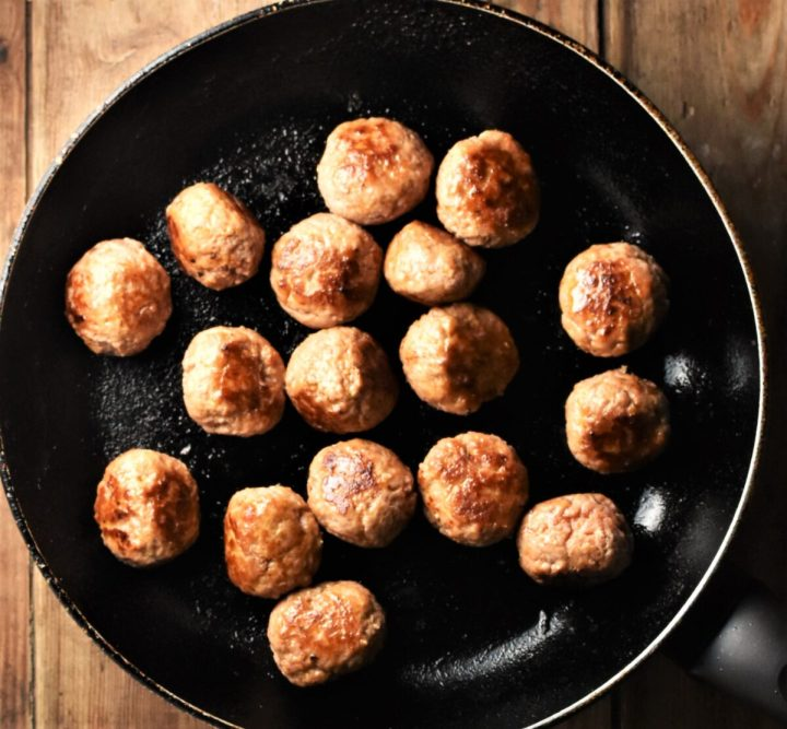 Fried meatballs in large pan.