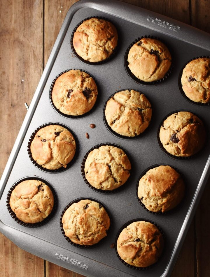 12 chocolate chip muffins in muffin pan.