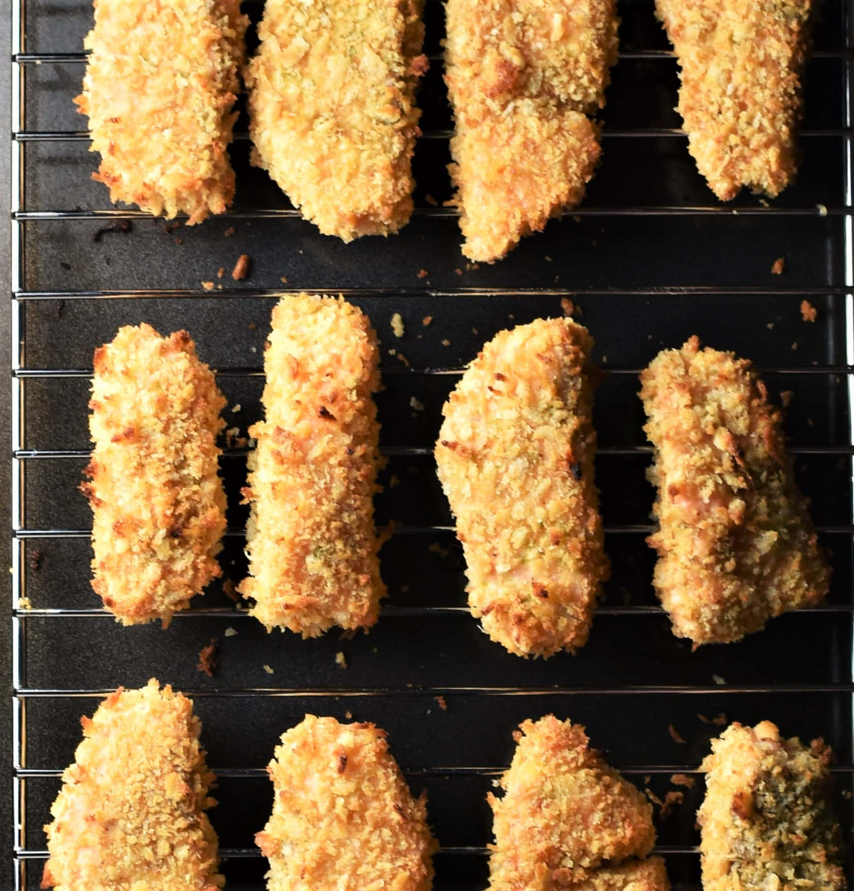 Crispy baked salmon fingers on top of rack.