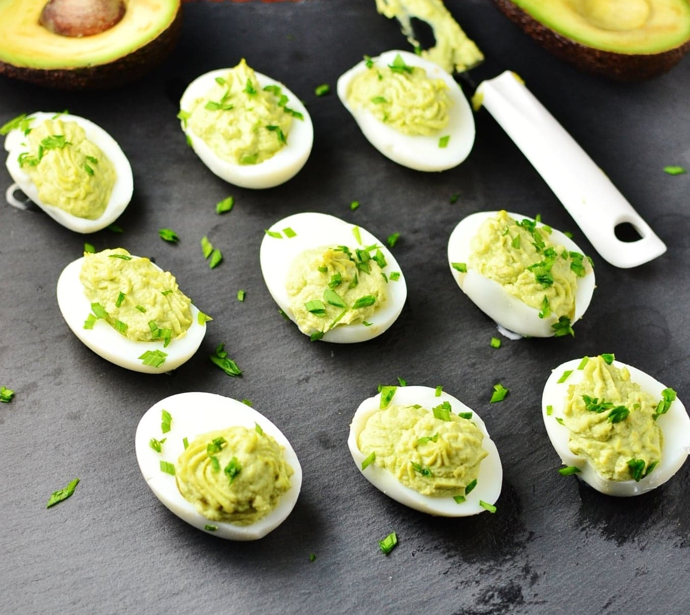 Deviled eggs on top of slate surface.
