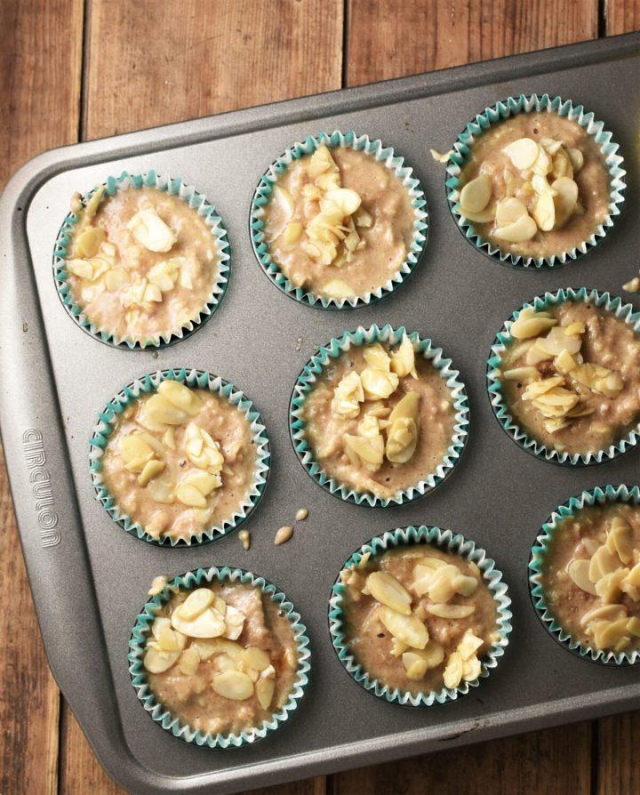 Apple muffin batter in muffin pan.