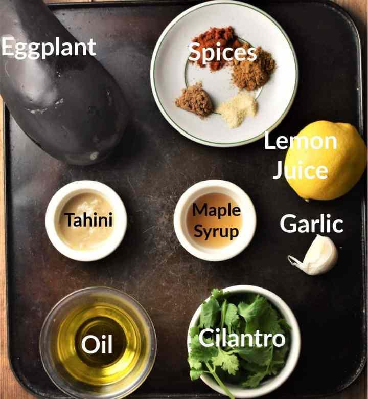 Eggplant dip ingredients in individual dishes.
