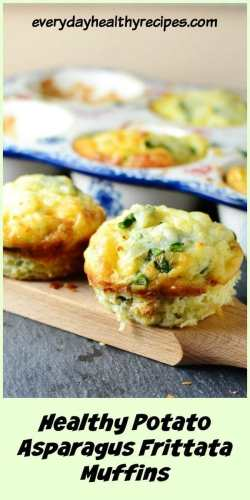 Close-up view of potato asparagus frittata muffins on top of wooden board, with muffins in ceramic muffin dish in background.