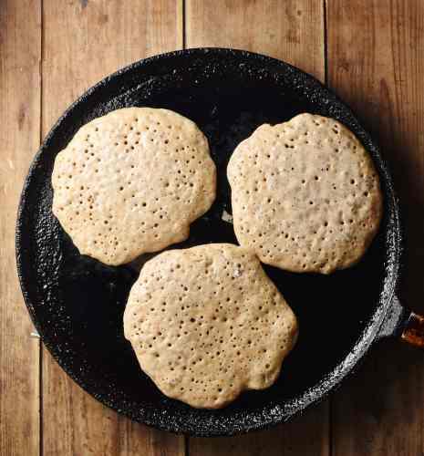 3 pancakes on top of pan.
