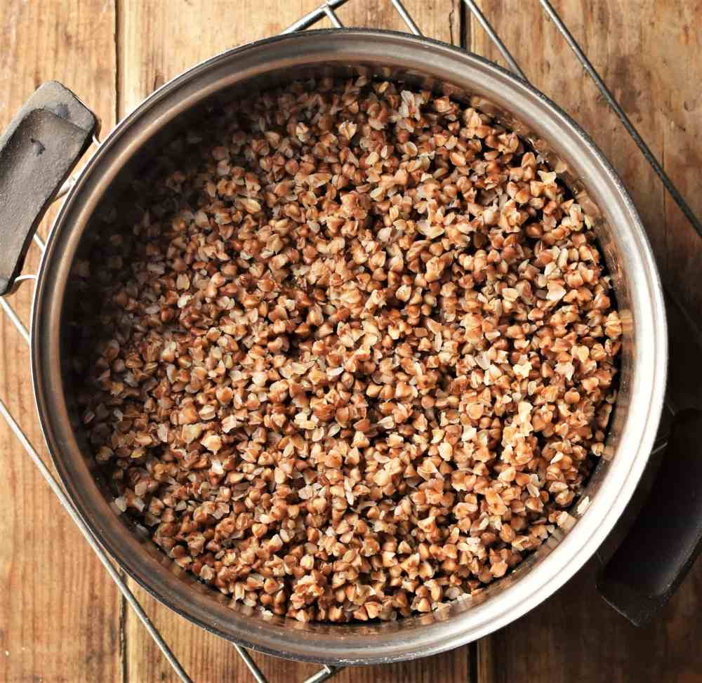 Top down view of cooked buckwheat in pot.