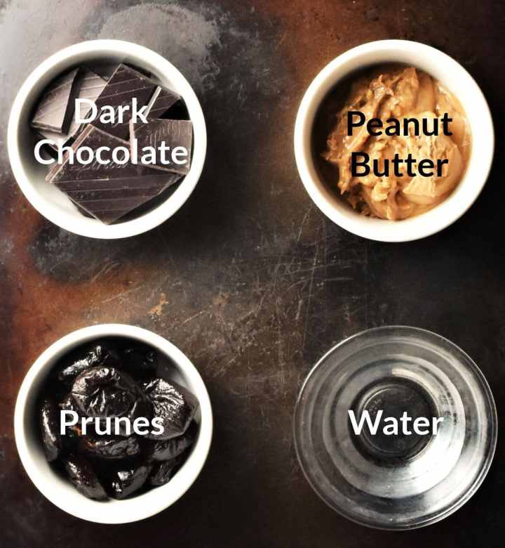 Ingredients for making chocolate prune energy balls in individual dishes.