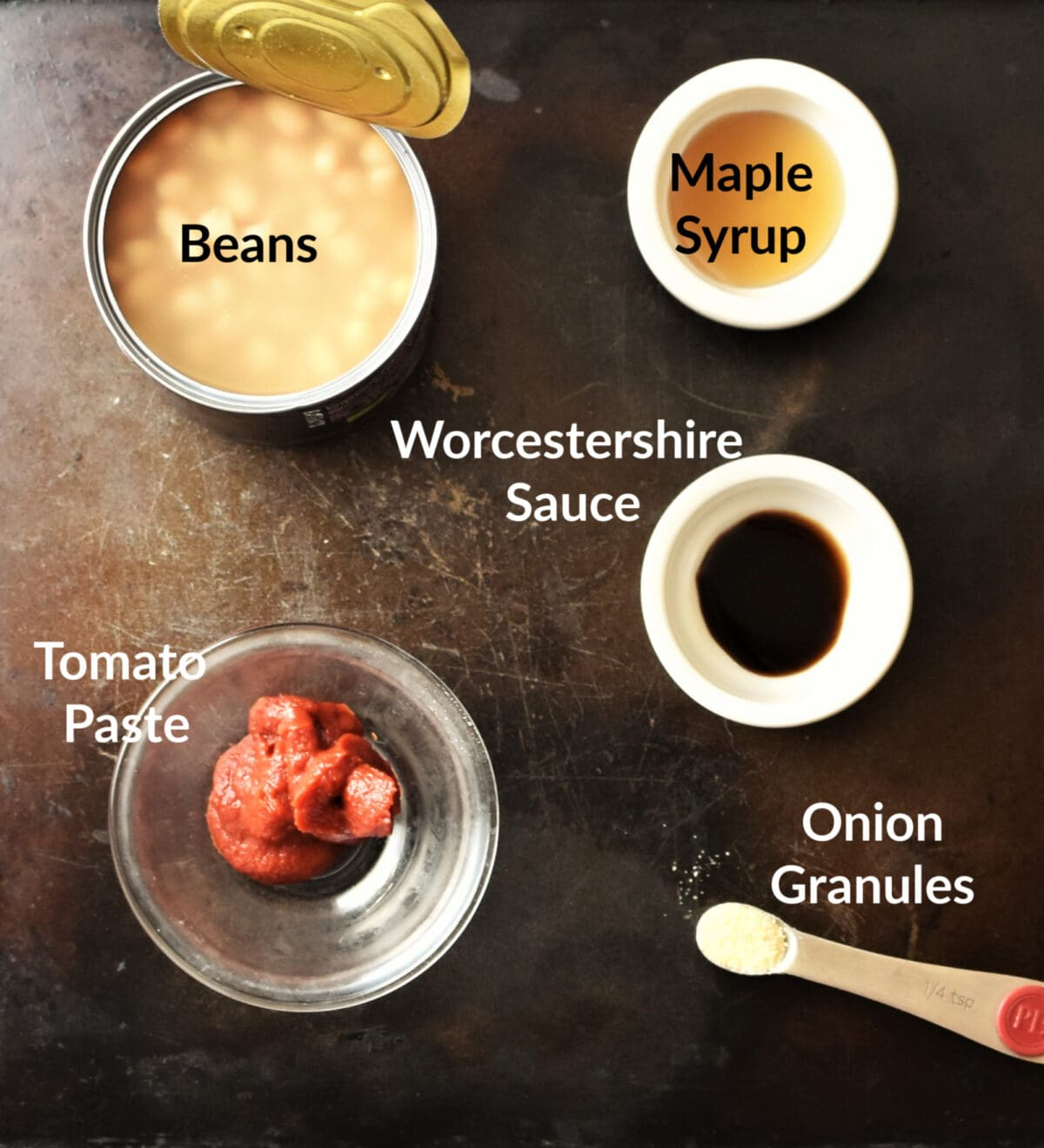 Baked beans ingredients in separate dishes.