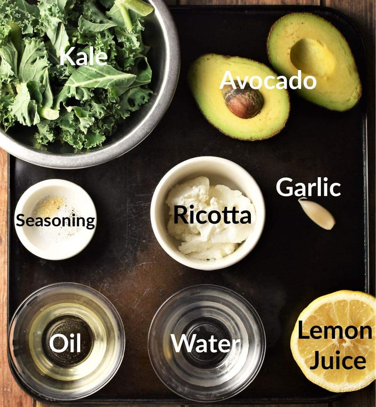 Kale dip ingredients in individual dishes.