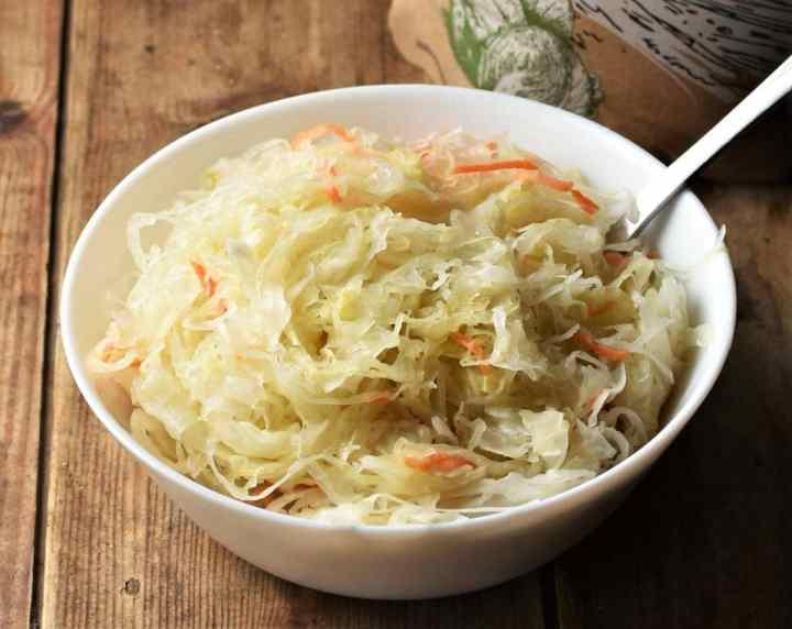 Sauerkraut in white bowl with fork.