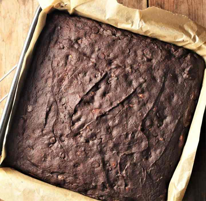 Top down view of brownie cake in square pan.
