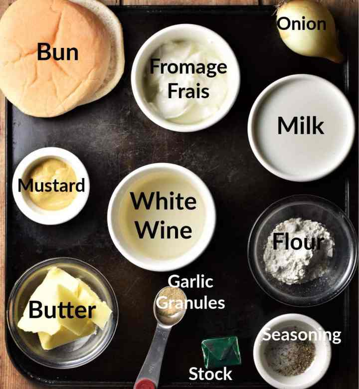 Meatballs and white sauce ingredients in individual dishes.